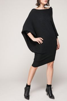 <p>Made from a soft wool-blend fabric. Boat neckline. Asymmetric design. Regular fit. About me:. 6% wool, 54% polyester, 20% nylon, 20% acrylic</p>