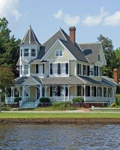 a wrap around porch, a circle tower room, and its on the water... Yes I want to live here!