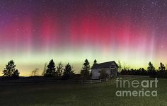 The Aurora Borealis lights up the sky over Foster's Bridge in Cabot Vermont on the night of Oct 8th 2013, by John Vose.