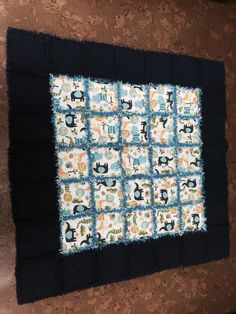 Baby boy rag quilt zoo animals. Approx 44x44.  Made with all new flannels.
