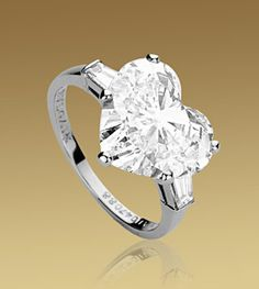 GRIFFE ring in platinum with heart cut diamond and 2 side diamonds. Available from 1 ct.A classic setting that allows the beauty and the pureness of the solitaire diamond to assert itself. Bvlgari Engagement Ring, Diamond Engagement Rings, Bvlgari Ring, Heart Shaped Engagement Rings, Heart Jewelry, Diamond Jewelry, Fine Jewelry, Diamond Rings, Heart Rings