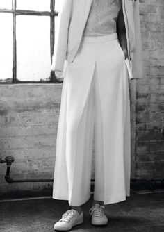 Pleated wide leg trousers; tailoring; pattern cutting; contemporary fashion // MO&Co. Spring 2015