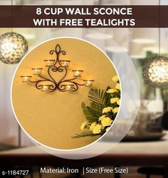 Candles & candle holders Cup Wall Sconce  Material: Iron Size: Free Size Description: It Has 8 Cup Wall Sconce With Free Tealights Country of Origin: India Sizes Available: Free Size   Catalog Rating: ★4.4 (1057)  Catalog Name: Home Decor Products Vol 7 CatalogID_148057 C127-SC1612 Code: 375-1184727-4611