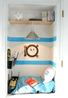 Interesting little cosy nook for kids to retreat or play in.  Boy's room redecorated to a nautical theme