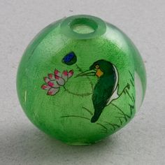 Reverse painted hollow glass bead, all hand painted, each side has a different design. Chinese. 28 mm diameter. 15 mm thickness. See detail page for closer view.