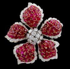 A David Webb ruby-and-diamond brooch (Yafa Jewelry).