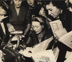 Simone de Beauvoir signing books. Brazil, 1960.