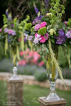 Anna and Spencer Photography, Atlanta Wedding Photographers. Outdoor Wedding Ceremony Alter Flowers. Purples, pink, and green flowers.