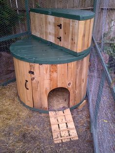 This is so cool!  It's a duck/chicken house made out of industrial spools!  They made a little half-bench and put it on top to store supplies.