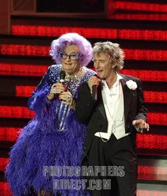 Rod Stewart portrait of the British singer performing live with Dame Edna Everage . RS : b . 10 January 1945 . Dame Edna Everage is characte...
