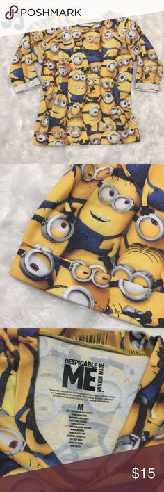 Despicable Me Top Adorable lightweight sweatshirt covered in Minions print from Despicable Me. 3/4 length cuffed/roll sleeves. Small amount of stretch ability. No flaws. See measurements in photos for sizing questions.  🔽🔽🔽🔽🔽🔽🔽🔽🔽🔽🔽🔽🔽🔽🔽🔽🔽🔽🔽🔽  • Reasonable offers accepted • Sorry, no modeling & no trades  🔼🔼🔼🔼🔼🔼🔼🔼🔼🔼🔼🔼🔼🔼🔼🔼🔼🔼🔼🔼 Despicable Me Tops Tees - Short Sleeve