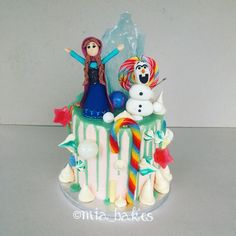 Dripped Frozen candy cake by mia_bakes