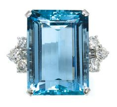 Aquamarine and Diamond Ring   White gold, centering one emerald-cut aquamarine approximately 26.75 cts., flanked by 6 round diamonds approximately 1.35 cts., approximately 10 dwt