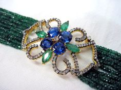 Gemvanity Presents A Wonderful Creation In A Form Of Bracelet In A True Art Deco Style Having 4 Round Blue Kyanites With 4 Pieces Of Marquise Emeralds & Diamonds With Emerald & Blue Sapphire Beads. See More @ www.gemvanity.com