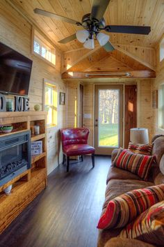 """The living room includes a built-in entertainment center with electric fireplace, 48"""" LCD TV, and a full size couch for a comfortable seating area."""
