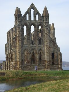 Ruins of Whitby Abbey in Yorkshire, inspiration for Bram Stoker when he wrote Dracula, England (by Inglewood Mum). This is a must for everyone, I love Whitby! Beautiful Ruins, Beautiful Buildings, Beautiful Places, Amazing Places, Abandoned Buildings, Abandoned Places, Places To Travel, Places To See, Places Ive Been
