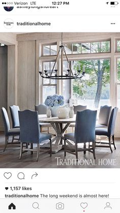 A U201cLolau201d Chandelier From Bungalow Classic Hangs Above The Round Elm Dining  Table. Floors Throughout The First Level Are Wide Plank Oak.