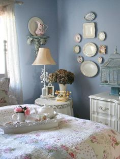 Do you ever catch yourself dreaming about having a royal teatime celebration with your friends and family? With this delicate bedroom you can enjoy your tea every day. The Rachel Ashwell-style bedding and dainty china (both in a tea set as well as hanging on the wall) add to the pristine white and blue tones of the room. Photo courtesy of My Romantic Home