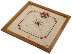 Carrom Board. Game play is most comparable to Billiards or Shuffleboard.