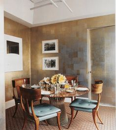 what a gorgeous combination of pieces. I want those chairs and love the reflective wallpaper. via STUDIO ANNETTA