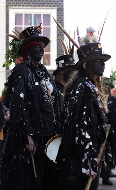 Hunters Moon Morris dancing group. The blacking of faces is a centuries old tradition, when begging was illegal in Britain the beggars would black their faces to avoid being recognised