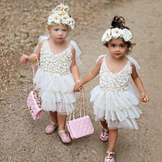 Little Miss Ever and Little Miss Ava couldn't be more destined to be best friends! These besties are ONLY 7 days apart... We promise we didn't plan it!  Flower crowns and dresses:  @avrycouturecreations  Chanel purses: @lovelythislovelythat  Shoes: @modernechild  PC: @littleredrosephotography