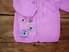 Hand-knitted baby cardigan made of a soft baby - acrylic. Does not irritate babys skin does not create allergies and maintained easily.  A great choice for а gift! Every little lady would be beautiful with it!  Approximate dimensions: 3-6m length - 28 cm = 11  chest width - 25 cm = 9 7/8  + gift :)  If you have questions - Id be happy to answer! :)