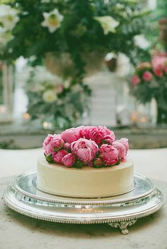 Single-Layer Wedding Cakes: A small cake piled with peonies looks regal atop an antique silver tray.