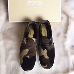 Michael Kors Keaton Camo Calf Hair SlipOn Sneakers New in box. Never worn, just tried on in store. On trend with the slip on style, these sneakers are so fab! Calf-hair camo print with brown leather detailing and white rubber sides and sole. Gold metal MK emblem detail on front and circular gold metal Michael Kors emblem on back. Elastic on both sides for stretch. ❌NO TRADES OR PAYPAL❌Please don't ask what's the lowest price...use the offer feature to negotiate! MICHAEL Michael Kors Shoes…