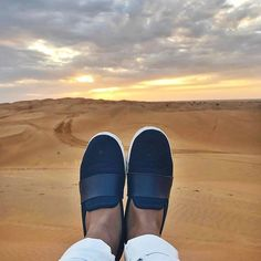 """Where do your SUAVS take you?  We're loving this shot of @tatianekozijn in her Navy Barton Slip Ons and the Dubai sunset.    #Repost  ・・・  """" You can't change what you refuse to confront.."""" ✨ Watching the sunset in the desert 🌵!! #thankgoditsfriday #Dubai #desert #mypointofview #whenthesungoesdown #middleeast #instamoments #lifeofatraveler #wanderlust #cheerstothefreakinweekend #meisjeindubai #photooftheday #quoteoftheday"""