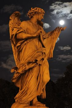 Photo and caption by Youssef Abou Bakr / A bright Super Moon resting on the palm of a saintly statue. A magical moment that I had to capture before the moon slipped away./ Rome, Castel Sant Angelo bridge