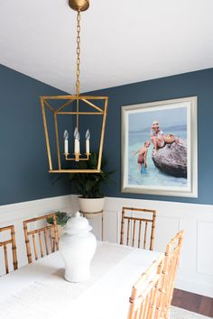 Dining area that doesn't take itself too seriously. Dusty blue: Benjamin Moore Mozart Blue similar shade