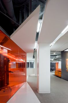 Kayak Startup Tech Office- florescent lit orange and white interior Corporate Office Design, Corporate Interiors, Workplace Design, Office Interiors, Interior Work, Office Interior Design, Orange Interior, Commercial Design, Commercial Interiors