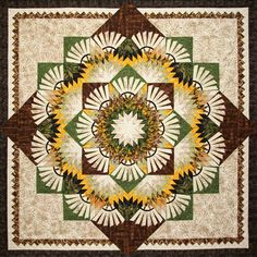 Woodcarver's Star: This design was inspired by the Reclaimed West Fabric line Designed by Judy and Judel Niemeyer with Timeless Treasures and is designed for foundation paper piecing by Bradley and Ju