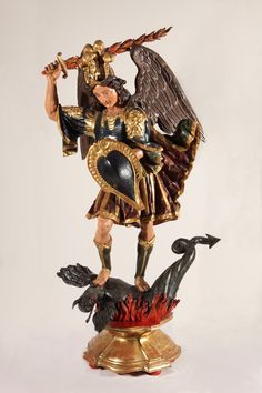Title: Archangel Michael Triumphant  Artist: Unidentified artist from Cuzco School  Region: Peru  Period: 17th century  Material: polychromed mahogany wood with gold and silver  Dimensions: 78 x 42 33 in. with base  On view in the museum