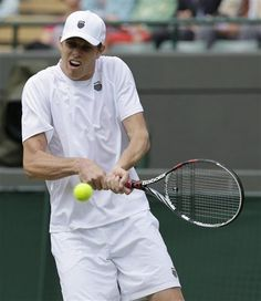 Sam Querrey of the United States returns a shot to Milos Raonic of Canada during a second round men's singles match at the All England Lawn Tennis Championships at Wimbledon, England, Friday, June 29, 2012. (AP Photo/Anja Niedringhaus)
