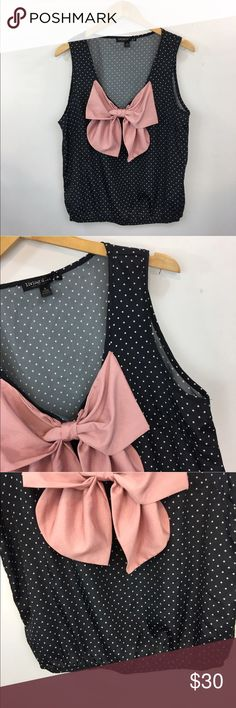 """Black and white polka dot bow top **** IF YOU THINK OUR AFFORDABLE PRICES ARE TOO HIGH FOR YOU, MAKE A REASONABLE OFFER ON ANY OF THE ITEMS IN OUR STORE AND WE MAY ACCEPT IT****     - Size: large  - Material: polyester  - Condition: EXCELLENT, brand new  - Color: black, white, pink  - Pockets: n/a  - Lined: n/a - Closure:  pullover  - Pair with:    *Measurements:   Bust: 40""""  Length: 23""""     * The more you buy the more you save. Feel free to ask any questions. Thank you for stopping by…"""