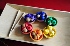 Rainbow acorns and bowls are a wonderful set of counting tools to add to our educational toys. These handheld manipulatives are great for counting, color sorting, working on fine motor skills as well as pretend play. Hand painted with a nontoxic, soy or water based paint. Sometimes the