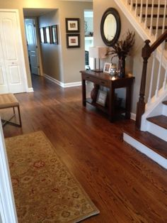 SW Balanced Beige 7307 paint color. Great warm balance with the hardwood floors and staircase.