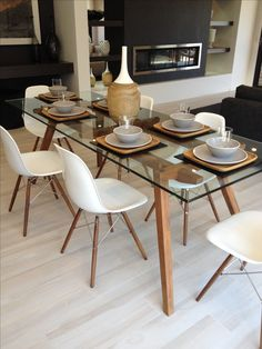 Sticotti glass dining table and Eames dining chairs in walnut
