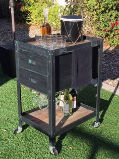 fun industrial bar cart with inlaid pallet wood top and bottom shelves  has gorgeous black and teal green chalk paint finish. two handy lined drawers and stemware rack to hold up to 9 glasses, caster wheels. $225  to purchase go to www.urbanoutlinedesign.com or email urbanoutlinedesign@gmail.com or call (480) 707 8171 #urbanoutline #urbanindustrial  #upcycled #retromodern #vintage #midcentury #forsale #design #vintagechic #handmade #treasure #create #retro #industrial #eclectic #fun #funky
