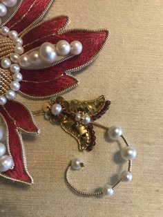 Garnet flower (by Larissa Borodich). Goldwork, stumpwork, silk shading, pearls, garnet beads, gold threads, plate, cords, check purl, pearl purl, etc. Size 8 x 6 in. app. Russian Embroidery, Jacobean Embroidery, Zardosi Embroidery, Pearl Embroidery, Baby Embroidery, Embroidery Fashion, Floral Embroidery, Embroidery Patterns, Gold Work