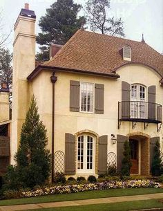 Love the shutters and colors- stucco with a little rock