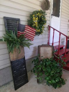 "old shutters. Old Shutter.with a burlap ""pocket"".filled with grungy flag & boston fern. Fill the pocket seasonally with related items. Old Shutters, Repurposed Shutters, Bedroom Shutters, Window Shutters, Happy Fourth Of July, July 4th, Olive Garden, Garden Route, Shabby"