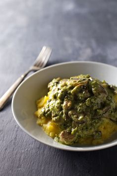 Creamy Poblano Mushrooms with Polenta - sauteed mushrooms in a roasted poblano sauce over creamy polenta! Comes together in 30 minutes with 350 calories per serving. | pinchofyum.com