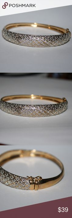 .925 GOLD Bangle bracelet fits a 7-8 inch wrist. Beautiful Vermiel Plating on this bracelet. stamped .925. There is one small diamond in the front (the rest make it look like there are diamonds) Buy from me with confidence! I have sold over 400 items with a 5 star rating! If you have any questions, do not hesitate to ask.  Looking at a few things in my shop? Put a bundle together, comment on an item that you are ready to check out and let me send you an even better offer!  Thank you for…