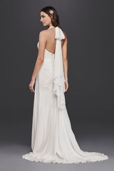 Add a little Hollywood glamour to your wedding day with this halter sheath wedding dress dress that lets everyone know it's your time to shine. Cascading chiffon and gathered side-pleating luxe up the look.  David's Bridal Collection  Polyester  Sweep train  Back zipper; fully lined  Dry clean  Imported