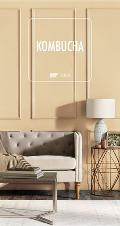 With its subtle gold undertones, the warm hue of Kombucha by BEHR Paint is sure to create a sense of happiness in every room of your home. This modern living room uses light gray and cream accent colors to highlight this neutral shade. Gold Paint Colors, Behr Paint Colors, Bedroom Paint Colors, Paint Colors For Living Room, Paint Colors For Home, House Colors, Interior Design Living Room, Living Room Decor, Interior Paint
