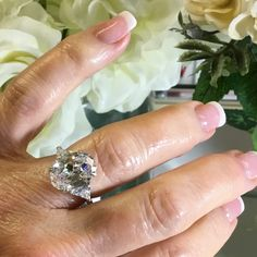 Top Quality Cubic Zirconia 5 Carat Ring 925 Solid Sterling Silver Top Quality Oval 5 Carat Cubic Zirconia , 10mm x 14mm Face, flanked by .25 carat Trillion Cut CZ on each side. This is quite the Stunning Sparkler! Jewelry Rings