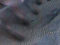 Aeolian bedforms (sand dunes shaped by wind) on Mars, captured by NASA's HiRISE telescope in November 2011.